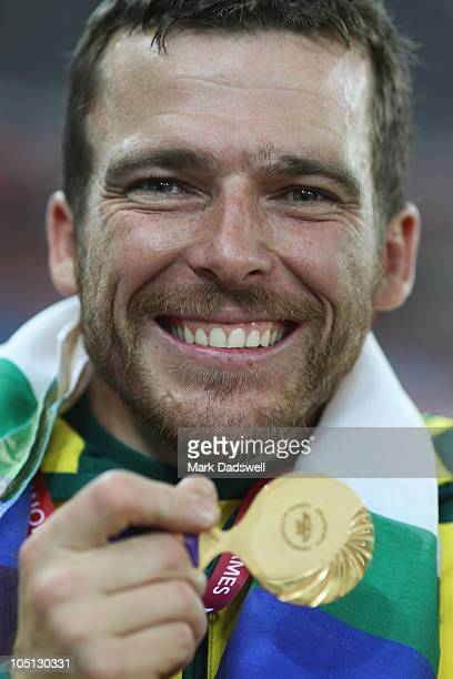Gold medalist Kurt Fearnley of Australia celebrates on the podium with his medal for the men's 1500 metres T54 at Jawaharlal Nehru Stadium during day...