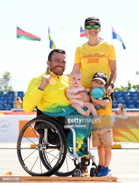 Gold medalist Kurt Fearnley of Australia celebrates with wife Sheridan son Harry and daughter Emilia during the medal ceremony for the Men's T54...