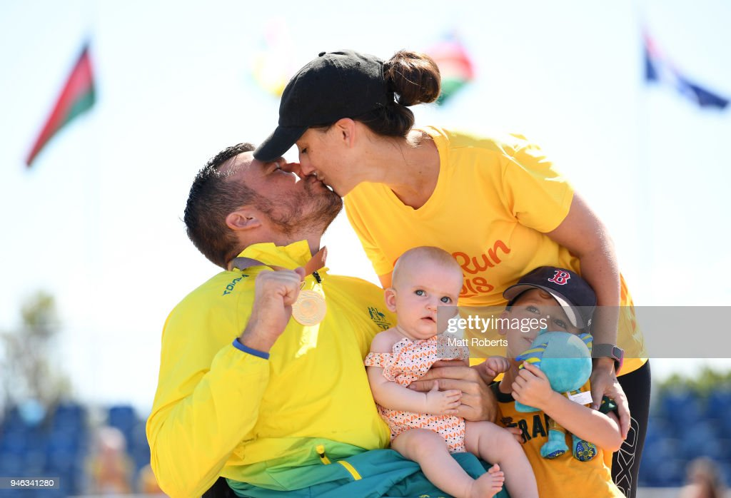 Gold medalist Kurt Fearnley of Australia celebrates with wife Sheridan, son Harry and daughter Emilia during the medal ceremony for the Men's T54 marathon on day 11 of the Gold Coast 2018 Commonwealth Games at Southport Broadwater Parklands on April 15, 2018 on the Gold Coast, Australia.