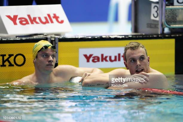 Gold medalist Kyle Chalmers of Australia and silver medalist Jack Cartwright of Australia look up the monitor after the Men's 100m Freestyle Final on...