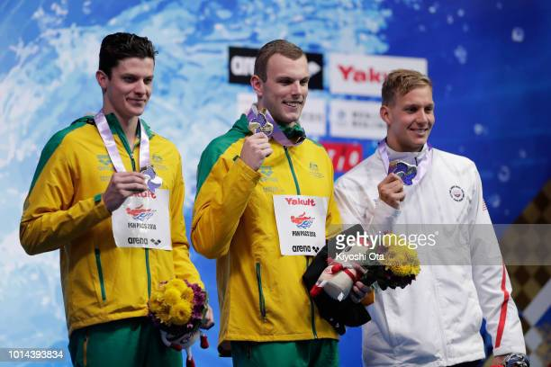 Gold medalist Kyle Chalmers of Australia joint silver medalists Jack Cartwright of Australia and Caeleb Dressel of the United States pose on the...