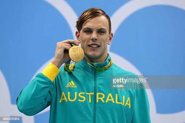 Gold medalist Kyle Chalmers of Australia poses on the podium during the medal ceremony for the Men's 100m Freestyle Final on Day 5 of the Rio 2016...