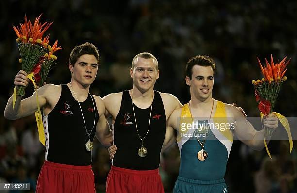 Gold medalist Kyle Shefwelt of Canada poses with fellow medal winners Samuel Offord of Australia and Nathan Gafuik of Canada after the Men's Vault...