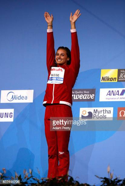 Gold medalist Kylie Jacqueline Masse of Canada celebrates during the medal ceremony for the Women's 100m Backstroke final on day twelve of the...