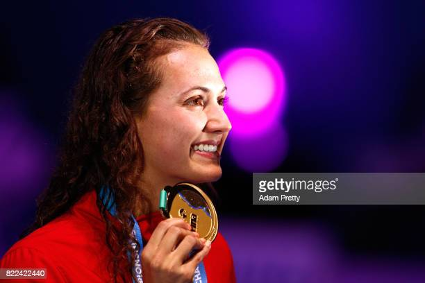 Gold medalist Kylie Jacqueline Masse of Canada poses with the medal won during the Women's 100m Backstroke final on day twelve of the Budapest 2017...