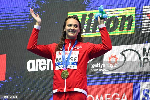Gold medalist Kylie Masse of Canada poses during the medal ceremony for the Women's 100m Backstroke Final on day three of the Gwangju 2019 FINA World...