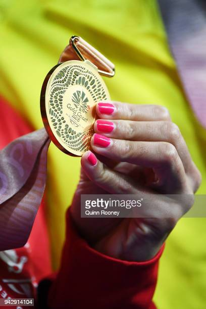 Gold medalist Kylie Masse of Canada poses during the medal ceremony for the Women's 100m Backstroke Final on day three of the Gold Coast 2018...