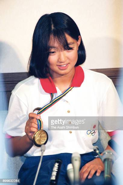 Gold medalist Kyoko Iwasaki attends a press conference on arrival at Narita International Airport on August 4 1992 in Narita Chiba Japan