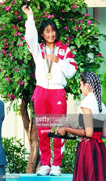 Gold medalist Kyoko Iwasaki of Japan celebrates on the podium at the medal ceremony for the Women's 200m Breaststroke during day three of the...