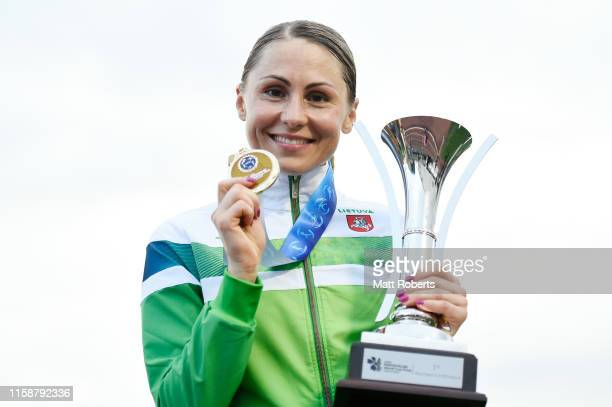 Gold medalist Laura Asadauskaite of Lithuania poses with the winners trophy during day two of the UIPM World Cup Modern Pentathlon test event for the...