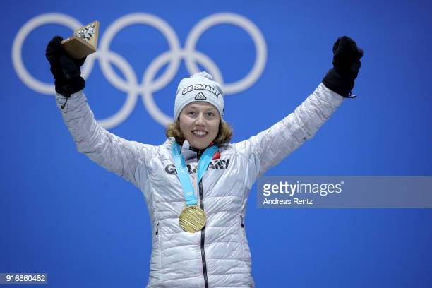 Gold medalist Laura Dahlmeier of Germany celebrates on the podium during the Medal Ceremony for the Women's Biathlon 75 km Sprint on day two of the...