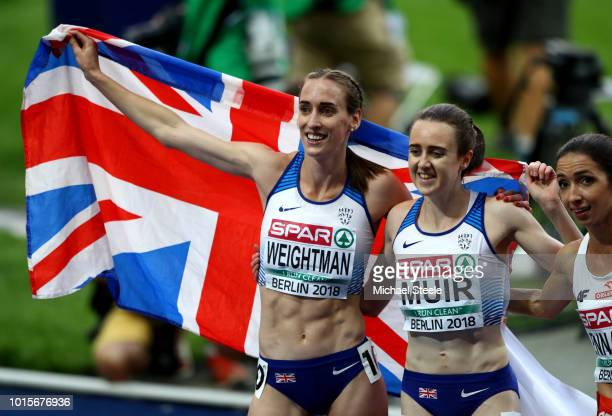 Gold medalist Laura Muir and bronze medalist Laura Weightman of Great Britain celebrate after wining their respective medals in the Women's 1500m...