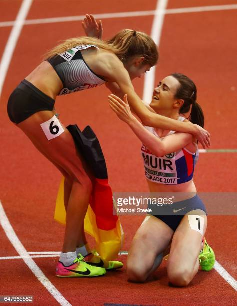 Gold medalist Laura Muir of Great Britain is congratulated by silver medalist Konstanze Klosterhalfen of Germany following the Women's 1500 metres...