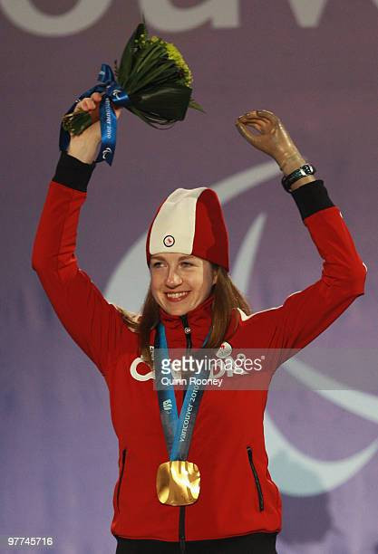 Gold medalist Lauren Woolstencroft of Canada celebrates during the medal ceremony for the Women's Standing Slalom on Day 4 of the 2010 Vancouver...