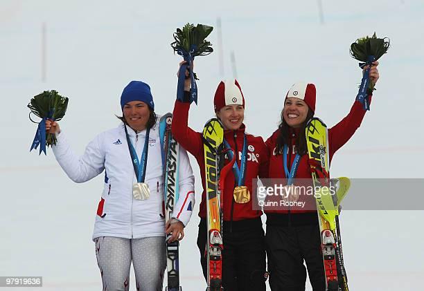 Gold medalist Lauren Woolstencroft of Canada celebrates with silver medalist Solene Jambaque of France and bronze medalist Karolina Wisniewska of...