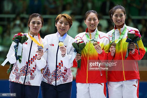 Gold medalist Lee Rajin of South Korea Silver Medalist Kim Jiyeon of South Korea and joint Bronze medalists Li Fei and Shen Chen of China pose atop...