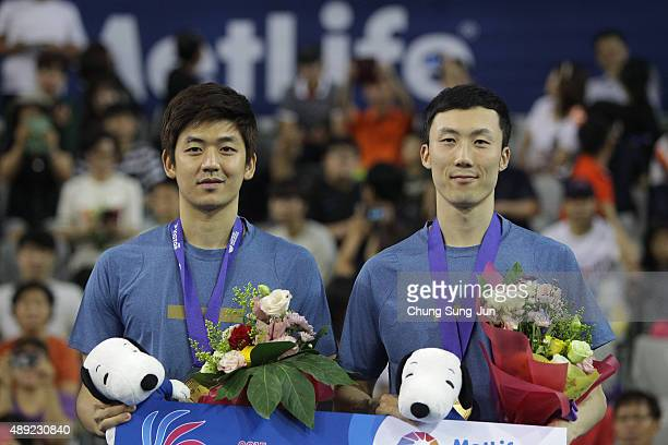 Gold medalist Lee YongDae and Yoo YeonSeong of South Korea pose on the podium after the Men's Double final match of the 2015 Viktor Korea Badminton...