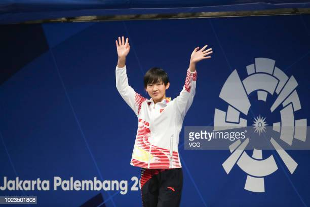 Gold medalist Li Bingjie celebrates after the Women's 200m Freestyle Swimming Final on day four of the 2018 Asian Games on August 22 2018 in Jakarta...
