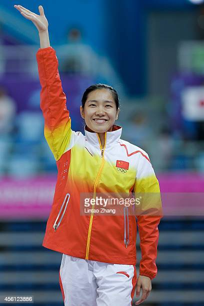 Gold medalist Li Dan of China celebrates during the medal ceremony after the Gymnastics Trampoline Women's Final in day seven of the 2014 Asian Games...