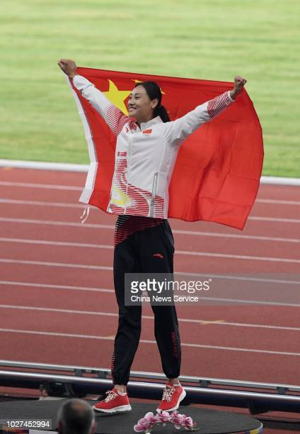 Gold medalist Li Ling of China celebrates after winning Women's Pole Vault Final on day ten of the 2018 Asian Games on August 28 2018 in Jakarta...