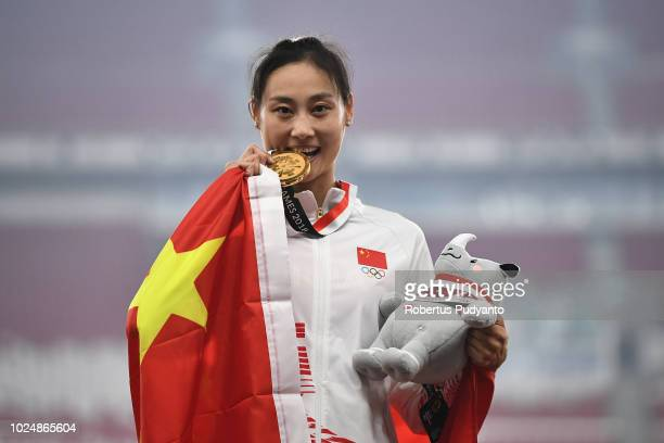 Gold medalist Li Ling of China celebrates on the podium during Women's Pole Vault medals ceremony on day ten of the Asian Games on August 28 2018 in...