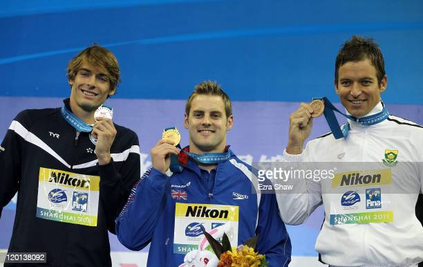 Gold medalist Liam Tancock of Great Britain poses with silver medalist Camille Lacourt of France and bronze medalist Gerhard Zandberg of South Africa...