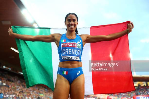 Gold medalist Libania Grenot of Italy celebrates with the Italian national flag after the Women's 400 metres final during day four of the 22nd...
