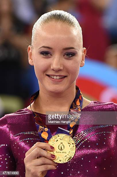 Gold medalist Lieke Wevers of the Netherlands poses on the podium during the medal ceremony for the the Women's Beam final on day eight of the Baku...