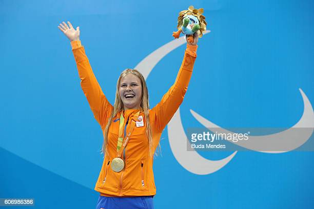 Gold medalist Liesette Bruinsma of the Netherlands celebrates on the podium at the medal ceremony for Women's 200m Individual Medley - SM11 Final on...