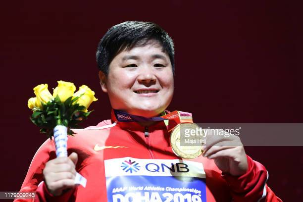Gold medalist Lijiao Gong of China stands on the podium during the medal ceremony for the Women's Shot Put final during day eight of 17th IAAF World...