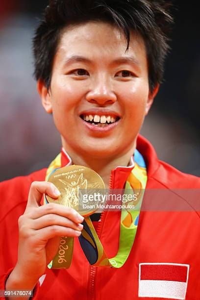 Gold medalist Liliyana Natsir of Indonesia celebrates after winning Mixed Doubles Gold Medal Match against Peng Soon Chan and Liu Ying Goh of...