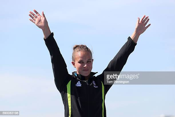 Gold medalist Lisa Carrington of New Zealand celebrates on the podium during the Women's Kayak Single 200m A on Day 11 of the Rio 2016 Olympic Games...