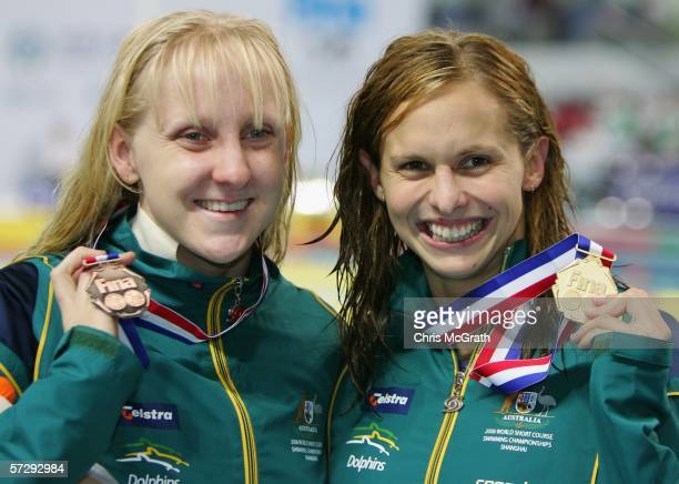 Gold medalist Lisbeth Lenton of Australia and bronze medalist Jessicah Schipper of Australia pose after the medal ceremony for the Women's 100m...