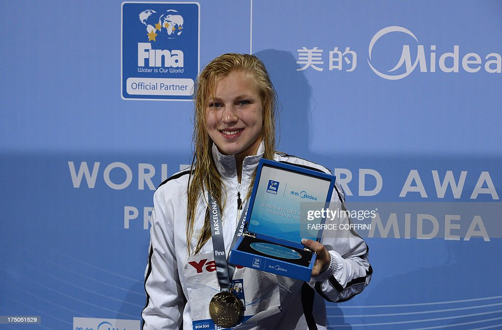 Gold medalist Lithuania's Ruta Meilutyte poses during the award ceremony of the women's 100-metre breaststroke swimming event in the FINA World Championships at Palau Sant Jordi in Barcelona on Jul...