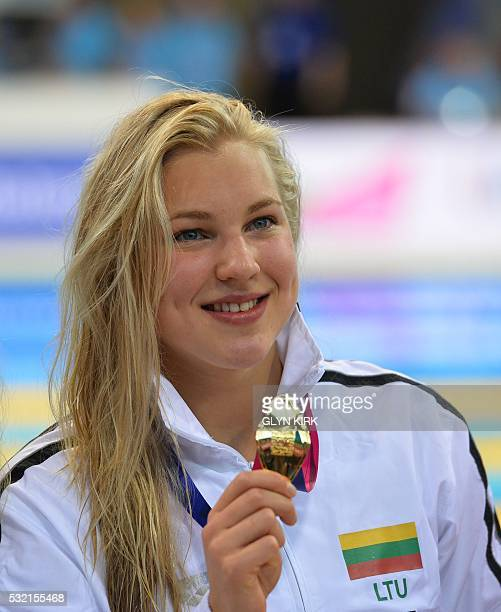 Gold medalist Lithuania's Ruta Meilutyte poses for a photograph after the final of the women's 100m Breaststroke swimming event on Day 10 of the...