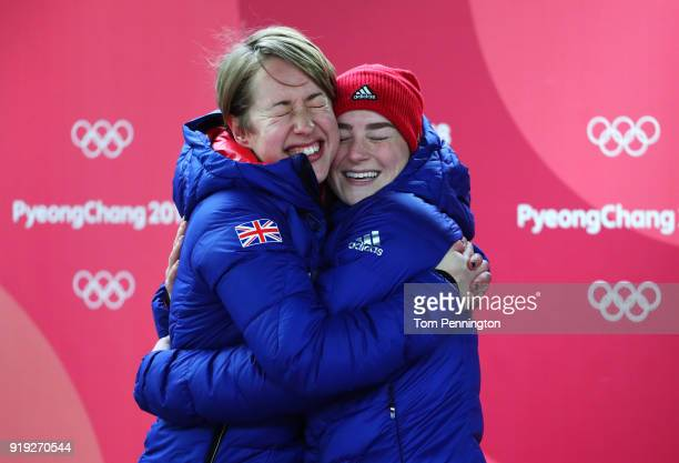 Gold medalist Lizzy Yarnold of Great Britain and bronze medalist Laura Deas of Great Britain embrace after the Women's Skeleton on day eight of the...