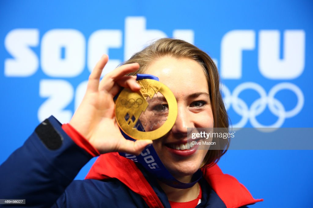 Gold medalist Lizzy Yarnold of Great Britain celebrates during the medal ceremony for the Women's Skelton on day 8 of the Sochi 2014 Winter Olympics at Medals Plaza on February 15, 2014 in Sochi, Russia.