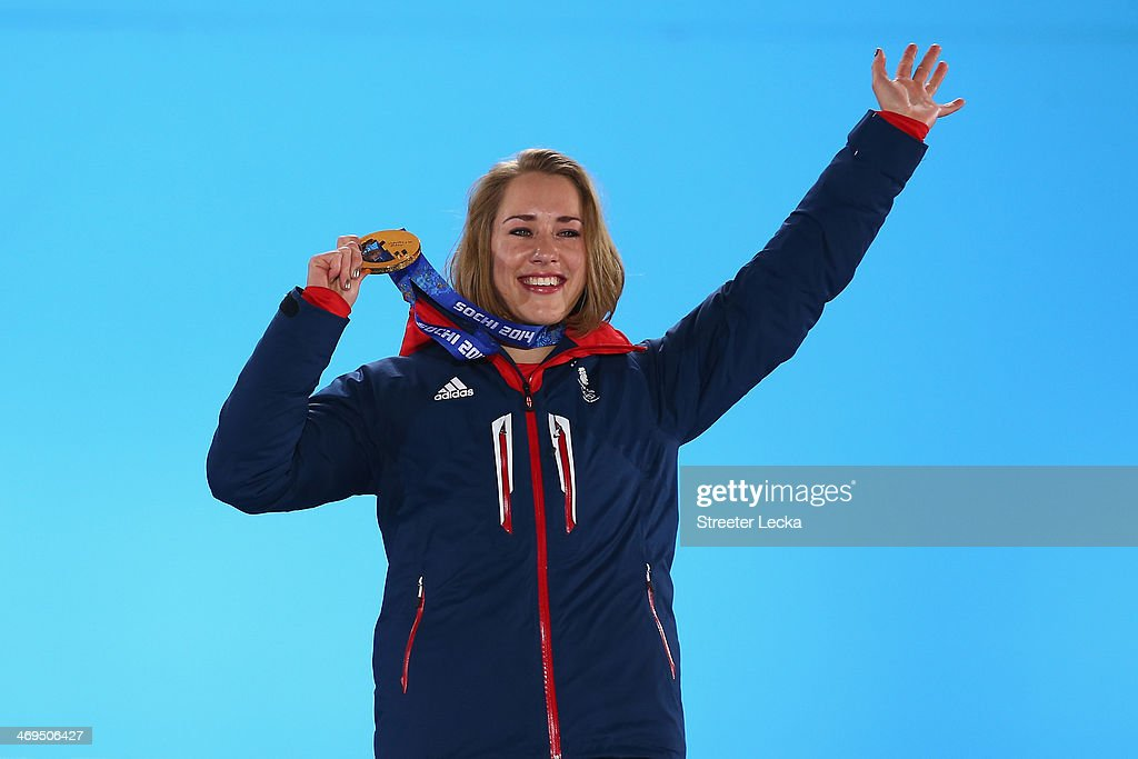 Gold medalist Lizzy Yarnold of Great Britain celebrates on the podium during the medal ceremony for the Women's Skelton on day 8 of the Sochi 2014 Winter Olympics at Medals Plaza on February 15, 2014 in Sochi, Russia.