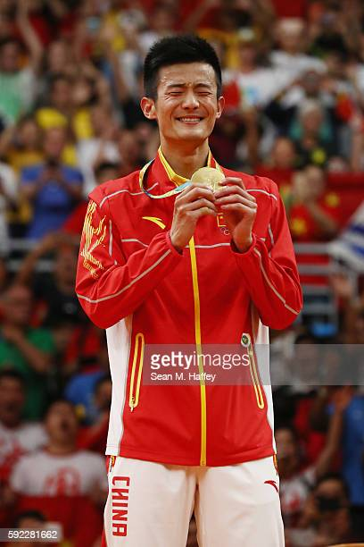 Gold medalist Long Chen of China poses on the podium during the medal ceremony for the Men's Singles Badminton on Day 15 of the Rio 2016 Olympic...