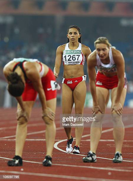Gold medalist Louise Hazel of England looks up at the scoreboard as bronze medalist Grace Clements of England and Jessica Zelinka of Canada catch...