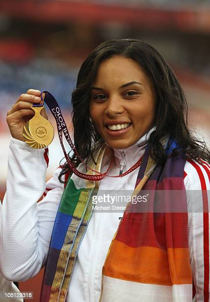 Gold medalist Louise Hazel of England poses with her medal during the presentation for the women's heptathlon at Jawaharlal Nehru Stadium during day...