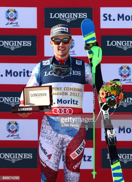 Gold medalist Luca Aerni of Switzerland celebrates during the flower ceremony for the Men's Combined Slalom during the FIS Alpine World Ski...