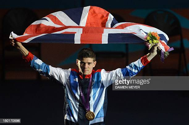 Gold medalist Luke Campbell of Great Britain celebrates with the British national flag during the awards ceremony for the Bantamweight boxing...