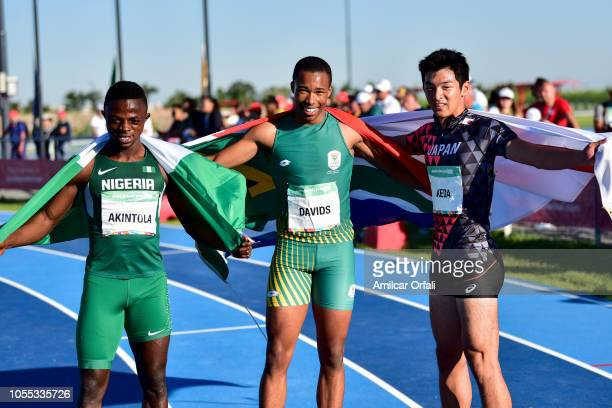 Gold Medalist Luke Davids of South Africa poses with Silver medalist Olukunle Alaba Akintola of Nigeria and Bronze medalist Seiryo Ikeda of Japan...