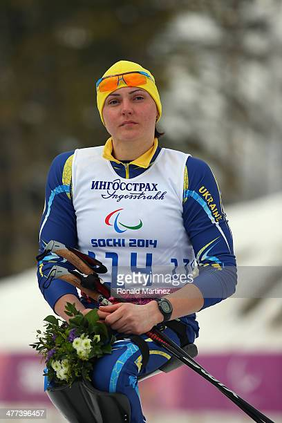 Gold medalist Lyudmyla Pavlenko of Ukraine at the flower ceremony during day two of Sochi 2014 Paralympic Winter Games at Laura Crosscountry Ski...
