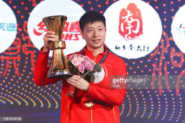 Gold medalist Ma Long poses with trophy after the Men's Singles final match on day four of the 2020 ITTF Finals at Zhengzhou Olympic Sports Center on...