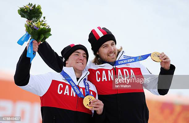 Gold medalist Mac Marcoux of Canada and guide Robin Femy celebrate during the medal ceremony for the Men's Giant Slalom Visually Impaired on day...