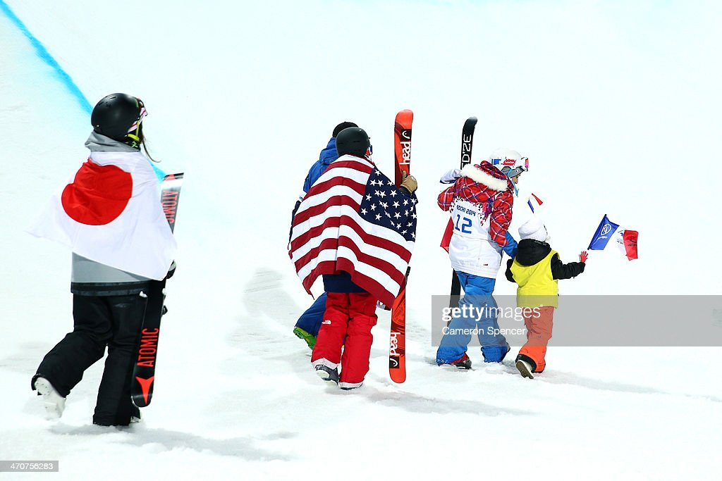 Gold medalist Maddie Bowman (C) of the United States walks to the podium with silver medalist Marie Martinod (R) of France and her daughter Melirose and bronze medalist Ayana Onozuka (L) of Japan during the flower ceremony in the Freestyle Skiing Ladies' Ski Halfpipe Finals on day thirteen of the 2014 Winter Olympics at Rosa Khutor Extreme Park on February 20, 2014 in Sochi, Russia.