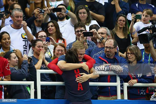 Gold medalist Madeline Dirado of the United States celebrates with loved ones during the medal ceremony for the Women's 200m Backstroke Final on Day...