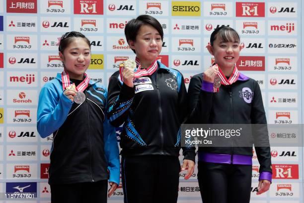 Gold medalist Mai Murakami celebrates with silver medalist Rina Aoki and bronze medalist Nene Suzuki at the award ceremony for the Women's Vault...